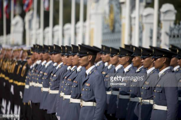 Members of the Royal Thai Air Force stand to attention ahead of a news conference at Government House in Bangkok Thailand on Tuesday March 21 2017...