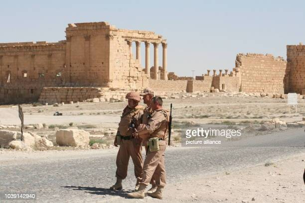 Members of the Russian Armed Forces pose next to the ancient ruins in PalmyraSyria 05 May 2016 Syrian troups supported by the Russian Armed Forces...