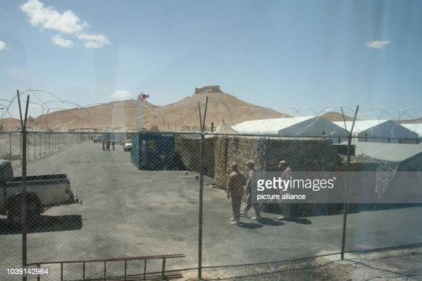 Members of the Russian Armed Forces walk through a new military camp in PalmyraSyria 05 May 2016 Syrian troups supported by the Russian Armed Forces...