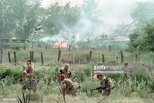 Members of the Russian Army 'special forces' enter in May 1996 in the Chechen stronghold of Bamut a village in western Chehnya during the battle...