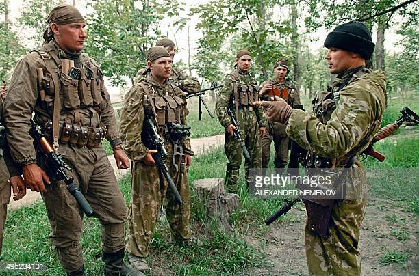 Members of the Russian Army 'special forces' listen to an officer as they prepare for a mission 18 May 1995 in Khankala on the eastern outskirts of...