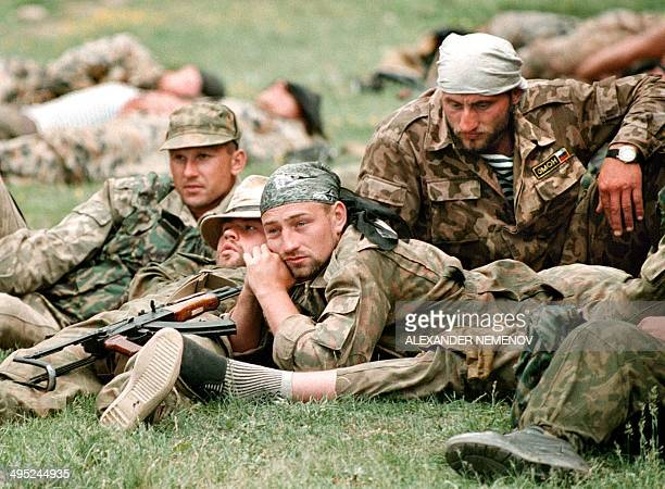 Members of the Russian Army 'special forces' relax in May 1996 in the Chechen village of UrusMartan 25 kilometres southwest of Grozny the capital of...