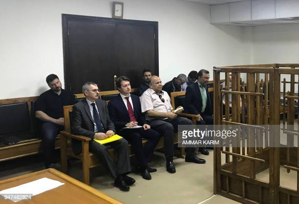 Members of the Russian diplomatic corps attend the trial of two Russian nationals at the Central penal Court in Baghdad on April 17 2018 Two Russian...