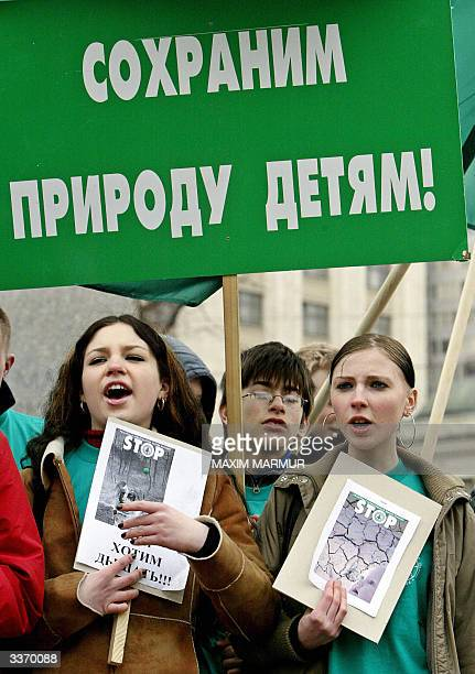 Members of the Russian Green Party shouts slogans as they hodl posters reading Safe Nature for children during a rally in Moscow 15 April 2004 as the...