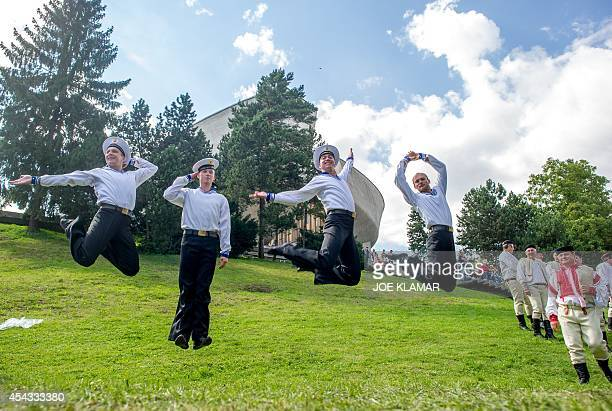 Members of the Russian group Alexanders warm up as they attend ceremonies to commemorate 70 years anniversary of the Slovakia's National Uprising at...