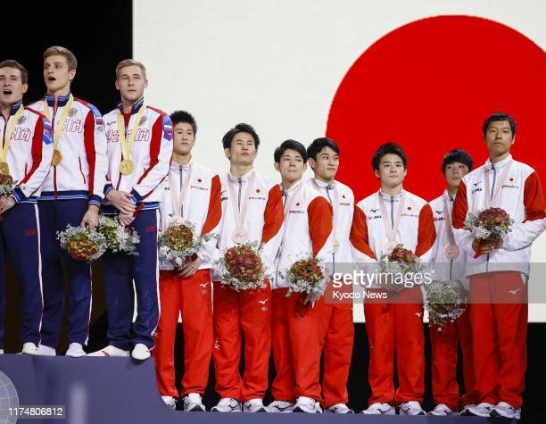 Members of the Russian men's gymnastics team stand on the podium after winning gold at the artistic gymnastics world championships in Stuttgart,...