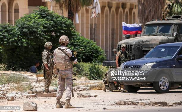 Members of the Russian military police are seen at the Nassib border crossing with Jordan in the southern province of Daraa on July 7 after the vital...