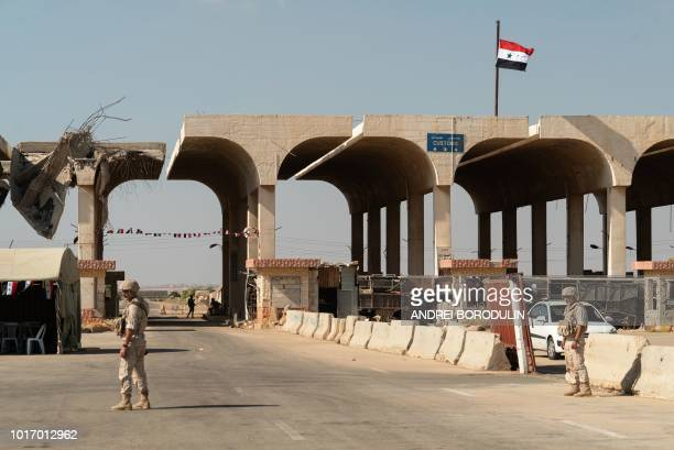 Members of the Russian military police patrol the Nassib border crossing with Jordan in the southern Syrian province of Daraa a on August 14 2018