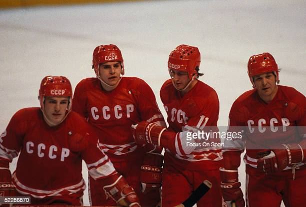 Members of the Russian team come together after scoring against team USA during the XIII Olympic Winter Games in February of 1980 in Lake Placid, New...
