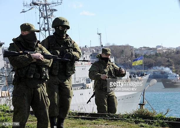 Members of the Russian troops stand guard near the Ukrainian navy ship Slavutich in the harbor of the Ukrainian city of Sevastopol on March 5 2014...