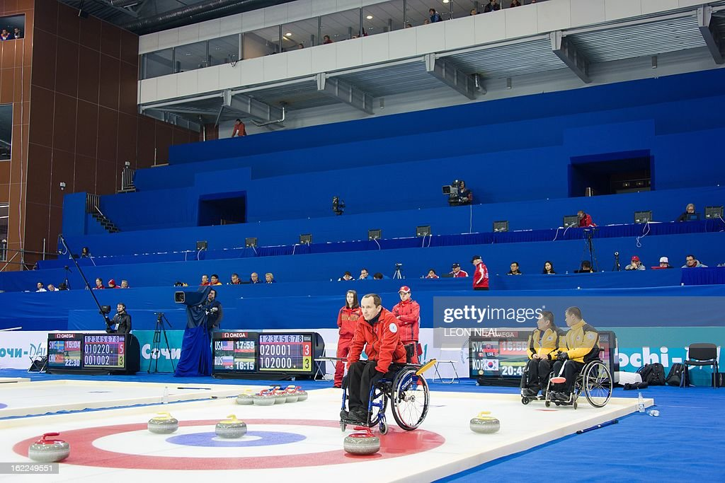 Members of the Russian Wheelchair Curling team take part in a test event at the Olympic Curling Centre in Adler, Russia on February 21, 2013. With a year to go until the Sochi 2014 Winter Games, construction work continues as tests events and World Championship competitions are underway.