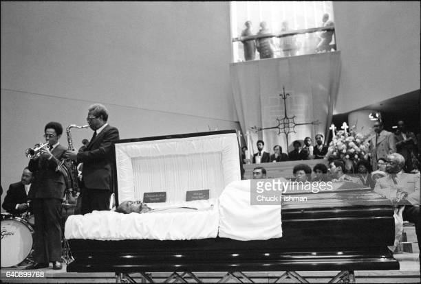 Members of the Rutgers Jazz Ensemble perform beside the open casket of Thelonious Monk during his funeral at St Peter's Church New York New York...