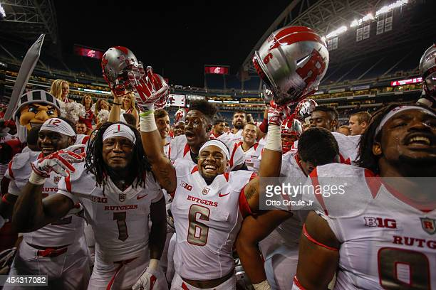 Members of the Rutgers Scarlet Knights celebrate after defeating the Washington State Cougars 4138 at CenturyLink Field on August 28 2014 in Seattle...