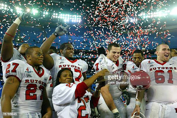 Members of the Rutgers Scarlet Knights lead by Janet Rice celebrate after defeating the Ball State Cardinals during the International Bowl at the...