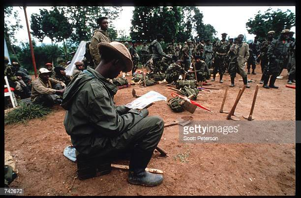 Members of the Rwandan Patriotic Front rebel army prepare to march into the city May 25 1994 in Kigali Rwanda Following the assassination of...