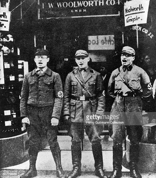 Members of the SA enforce a boycott of Jewish businesses in Berlin by blocking the entrance to a branch of F W Woolworth Co April 1933