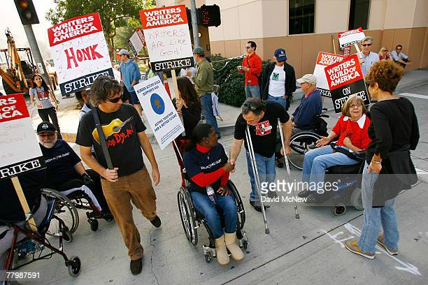 Members of the SAG/AFTRA/EQUITY Performers with Disabilities Committee join striking Hollywood writers on the picket line outside Warner Brothers...