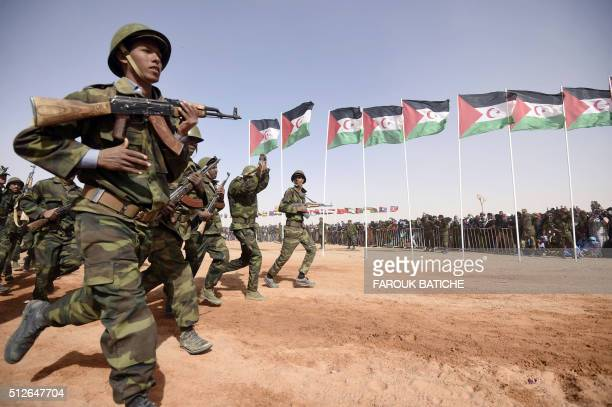 Members of the Sahrawi People's Liberation Army parade during a ceremony to mark 40 years after the Front proclaimed the Sahrawi Arab Democratic...