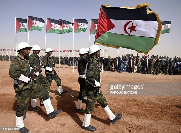 Members of the Sahrawi People's Liberation Army parade with Polisario Front's flags during a ceremony to mark 40 years after the Front proclaimed the...