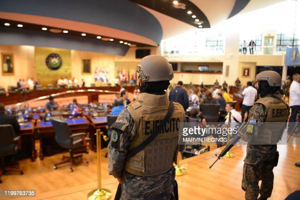 Members of the Salvadoran Armed Forces are seen within the Legislative Assembly during a protest outside the Legislative Assembly to make pressure on...