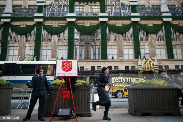Members of the Salvation Army sing and dance along Fifth Avenue in Midtown Manhattan December 18 2017 in New York City The city is decked out in...