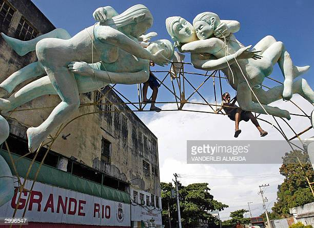 Members of the samba school Grande Rio put the finishing touches to their carnival float that shows two couples having sex in Rio de Janeiro Brazil...