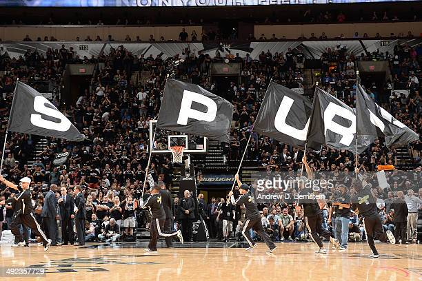 Members of the San Antonio Spurs cheer squad run onto the court with the Spurs Logo during a timeout against the Oklahoma City Thunder during Game...