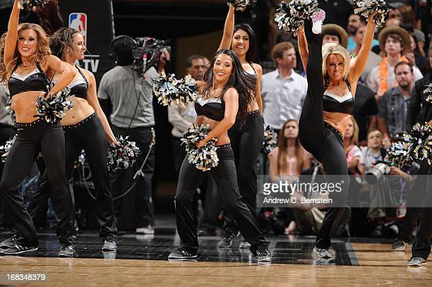 Members of the San Antonio Spurs Dance Team perform for the crowd against the Golden State Warriors in Game Two of the Western Conference Semifinals...
