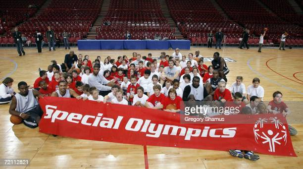 Members of the San Antonio Spurs pose with kids after the NBA Cares / Special Olympics clinic during the NBA Europe Live Tour presented by EA Sports...