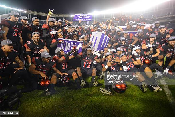 Members of the San Diego State Aztecs celebrate taking a group photo on the field after winning the Mountain West Championship game against the Air...