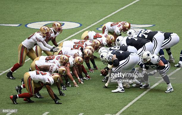 Members of the San Francisco 49ers line up against the Dallas Cowboys at Texas Stadium on November 23 2008 in Irving Texas