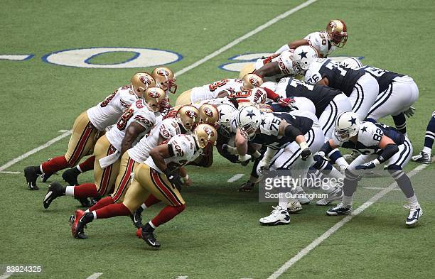 Members of the San Francisco 49ers rush against the Dallas Cowboys at Texas Stadium on November 23 2008 in Irving Texas
