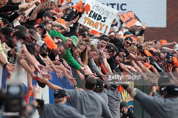 Members of the San Francisco Giants celebrate after defeating the San Diego Padres to win the National League West during a Major League Baseball...