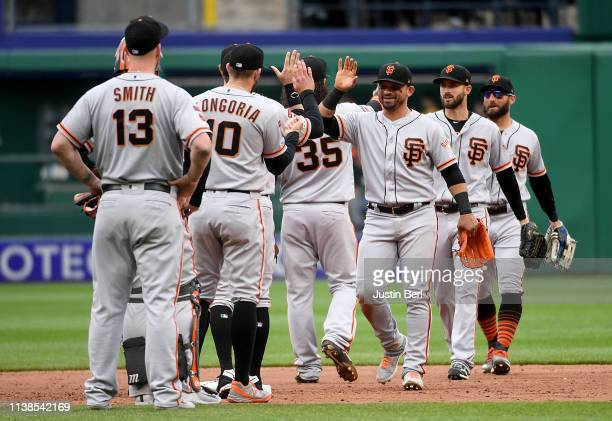 Members of the San Francisco Giants celebrate after the final out in a 32 win over the Pittsburgh Pirates at PNC Park on April 21 2019 in Pittsburgh...