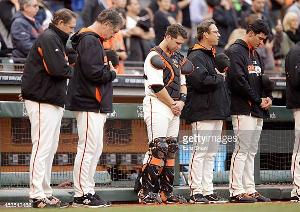 Members of the San Francisco Giants pitching coach Dave Righetti manager Bruce Bochy Buster Posey bench coach Ron Wotus and Javier Lopez stand for a...