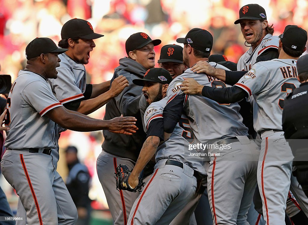 Members of the San Francisco Giants surround Sergio Romo #54 (center) after defeating the Cincinnati Reds in Game Five of the National League Division Series at the Great American Ball Park on October 11, 2012 in Cincinnati, Ohio. The Giants defeated the Reds 6-4.