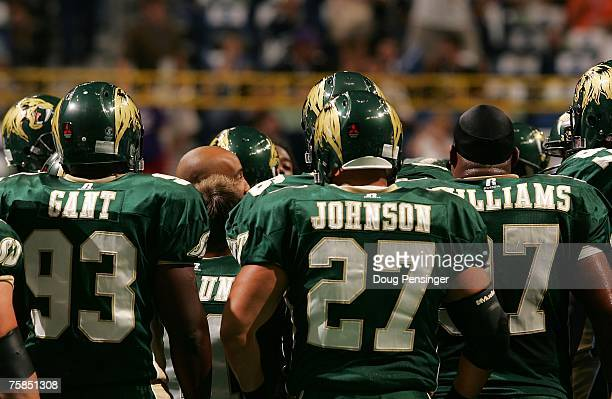 Members of the San Jose SaberCats huddle up around head coach Darren Arbet during warmups prior to ArenaBowl XXI against the Columbus Destroyers at...