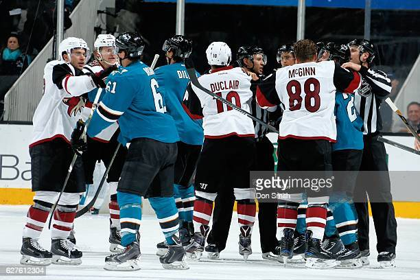 Members of the San Jose Sharks and the Arizona Coyotes shove each other during a NHL game at SAP Center at San Jose on November 29, 2016 in San Jose,...