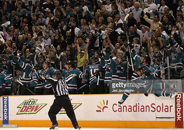 Members of the San Jose Sharks celebrate after defeating the Detroit Red Wings in Game Five of the Western Conference Semifinals during the 2010 NHL...