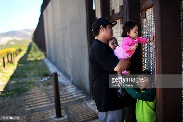Members of the Sandoval family visit loved ones by communicating through the USMexico border fence at Friendship Park in San Ysidro CA on Sunday...