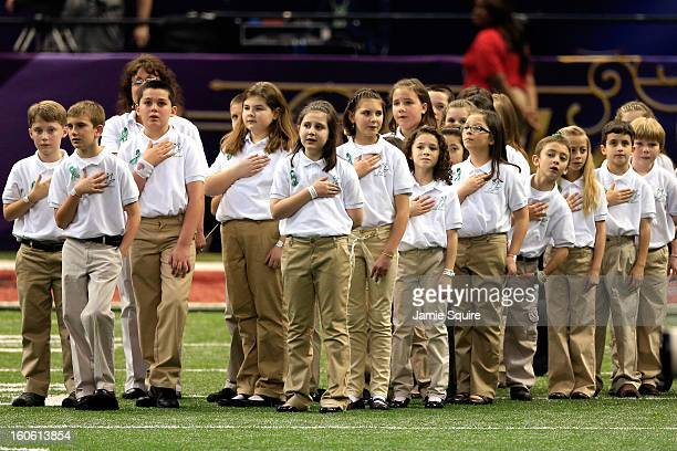 Members of the Sandy Hook Elementary School Chorus look on during the National Anthem prior to Super Bowl XLVII between the San Francisco 49ers and...