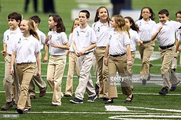 Members of the Sandy Hook Elementary School Chorus walk off the field after singing America The Beautiful prior to Super Bowl XLVII between the San...