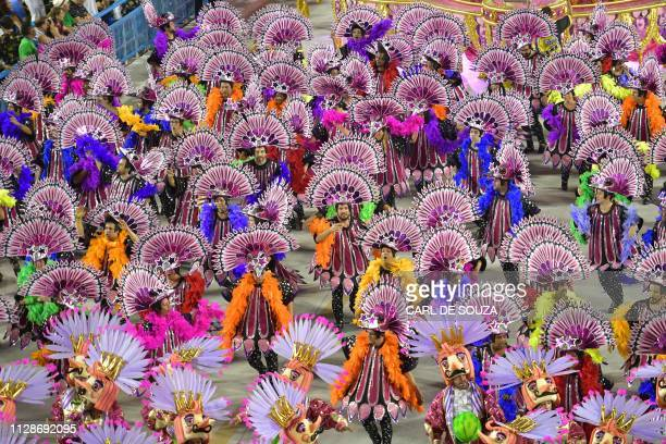 Members of the Sao Clemente samba school perform during the second night of Rio's Carnival parade at the Sambadrome in Rio de Janeiro Brazil on March...