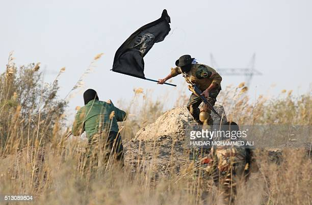Members of the Saraya alSalam a group formed by Iraqi Shiite Muslim cleric Moqtada alSadr take part in a military training session in the town of...
