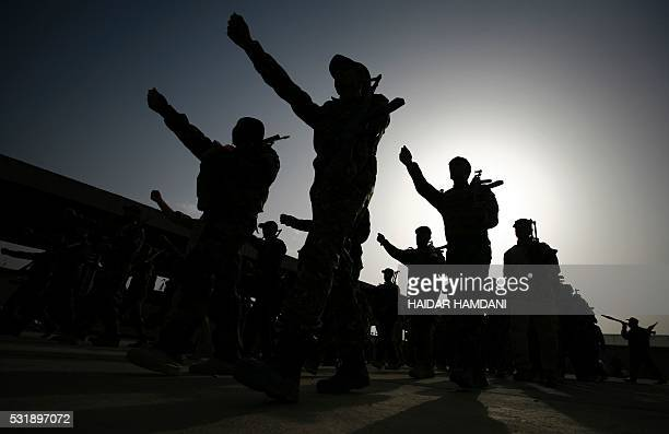 TOPSHOT Members of the Saraya alSalam a group formed by Iraqi Shiite Muslim cleric Moqtada alSadr march in Iraq's holy city of Najaf as they prepare...