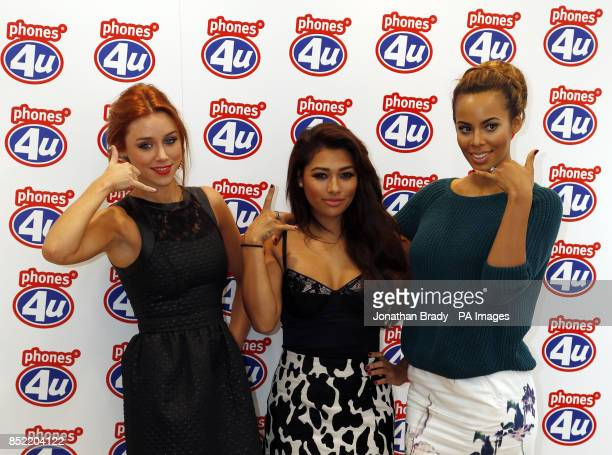 Members of the Saturdays Una Healy Vanessa White and Rochelle Humes attend a photocall for the launch of Apple's new iPhone 5s and 5c at Phones4U in...