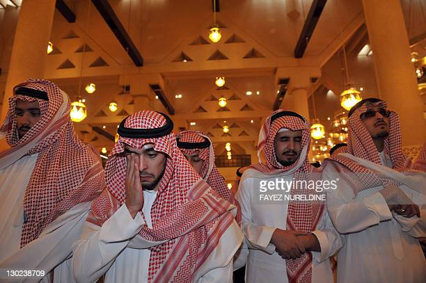 Members of the Saudi royal family attend the funeral of late Saudi Crown Prince Sultan bin Abdul Aziz at Imam Turki bin Abdullah mosque in Riyadh on...