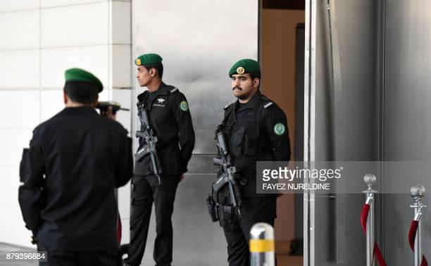 Members of the Saudi Royal Guard stand on duty outside the hall where the first meeting of the defence ministers of the 41member Saudiled Muslim...