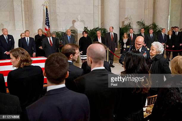 Members of the Scalia family are escorted to their seats as they arrive for a private ceremony in the Great Hall of the Supreme Court where late...