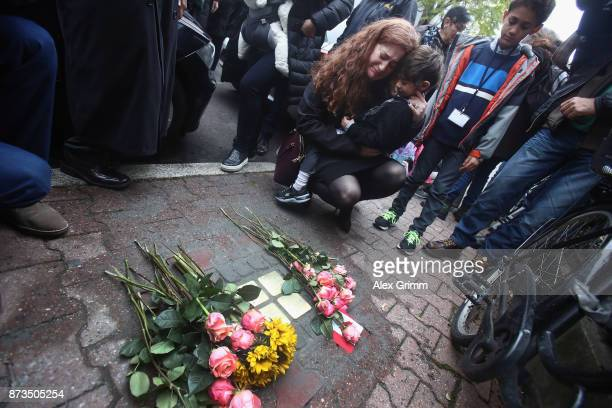 Members of the scattered Cohn family mourn after German artist Gunter Demnig layed four 'stumbling stones' to commemorate Jewish schoolgirl and...
